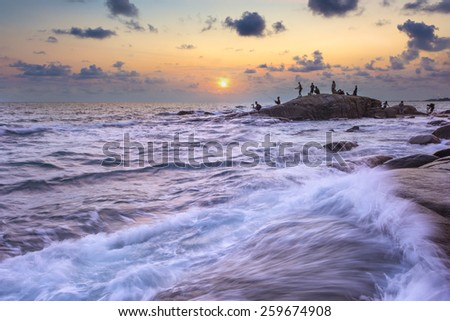 wave and the rock with sunset sky at rayong, Thailand. - stock photo