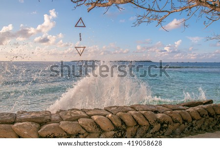 Wave attack big bag, barrier for protect Beach, Dream Catcher Maldives Island, Male city on background with cloudy sky and blue water, prevention for port, shields - stock photo
