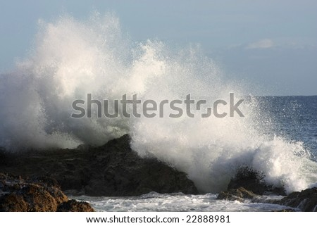 wave brakes on rocks