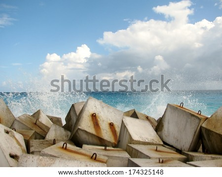 Wave breaker made of concrete cubes - stock photo