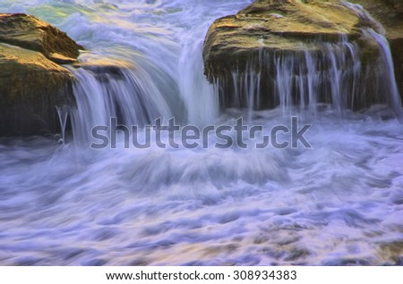 Wave Cascading Over Rocks