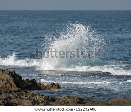 Wave crashes on the rocks - Mediterranean sea, Israel - stock photo