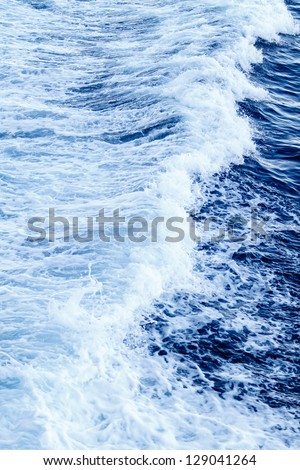 Wave of a ferry ship on the open ocean - stock photo