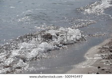 Wave of sea on sandy beach