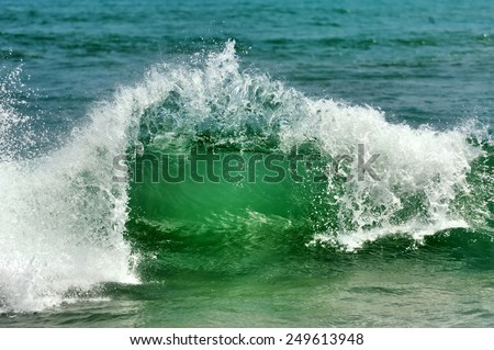 Wave of the ocean on the sand beach - stock photo
