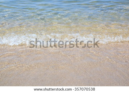 Wave of the sea on the sand beach and summer day