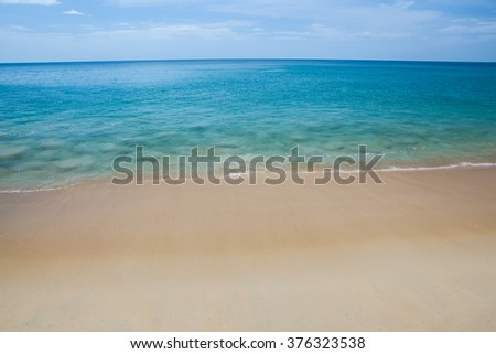 Wave of the sea on the sand beach in Thailand