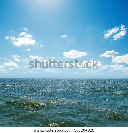 wave on sea and blue sky - stock photo