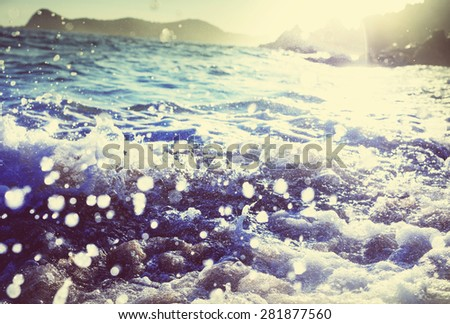 Wave on the beach - stock photo