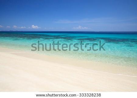 Wave on the sandy beach - stock photo