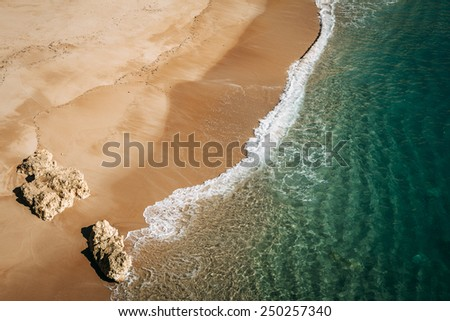 Wave on the small closed beach near Navy Beach (Praia da Marinha), located on the Atlantic coast in Caramujeira, Lagoa Municipality, Algarve. - stock photo