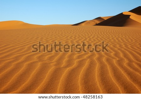 Wave pattern in desert dune - stock photo