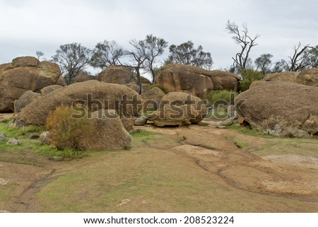 Wave Rock, granite boulders laying on top of the Wave Rock monolith near Hyden in Western Australia - stock photo