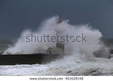 Wave rolls over the lighthouse