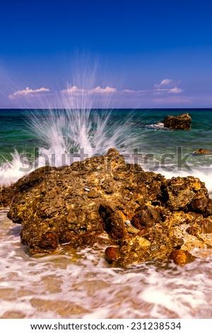 Wave Splashing on Rock. - stock photo