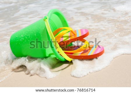 wave washing over beach supplies - stock photo