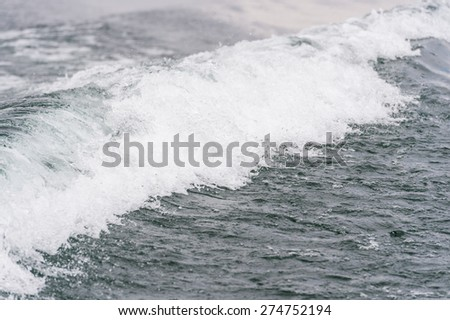 Wave water by cruise ship. - stock photo