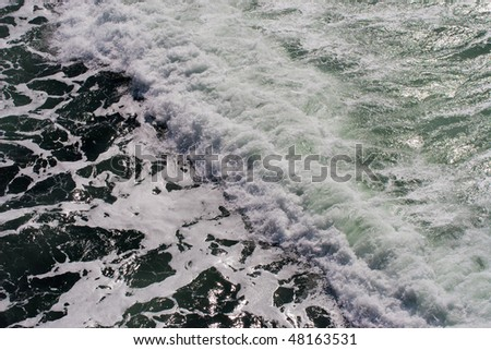 Wave with sea foam - stock photo