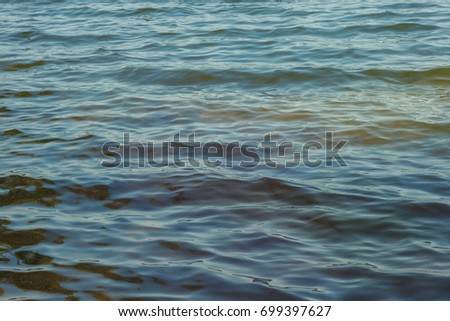 Waves and glare on the surface of the water. Lake. Background