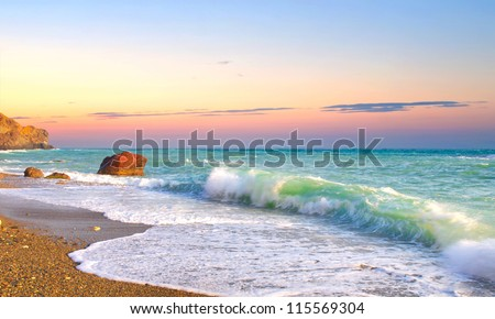 Waves and sky during sunset. - stock photo