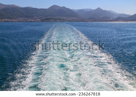 Waves at sea the boat after in Greece - stock photo