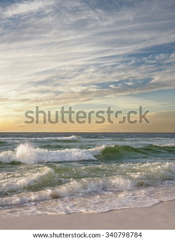 Waves Break on a Beautiful White Sand Florida Beach as the Sun Comes Up - stock photo