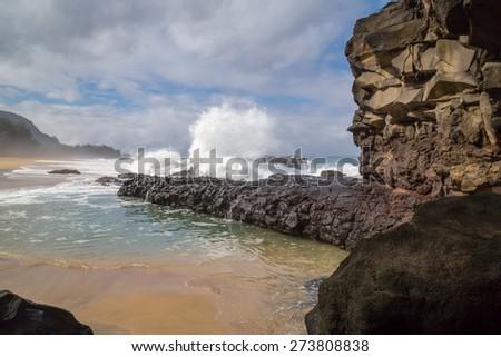 Waves breaking and crashing on the rocks at Lumahai Beach, near Makahoa Point,  Kauai, Hawaii - stock photo