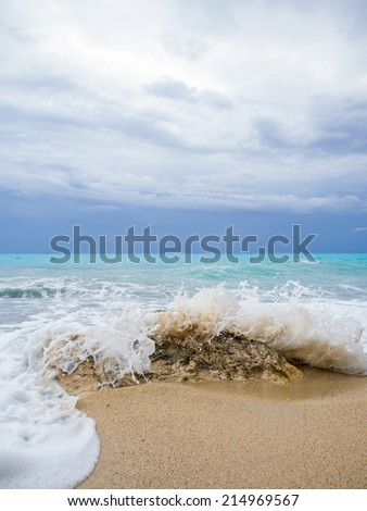 waves breaking on a stony beach during a thunderstorm