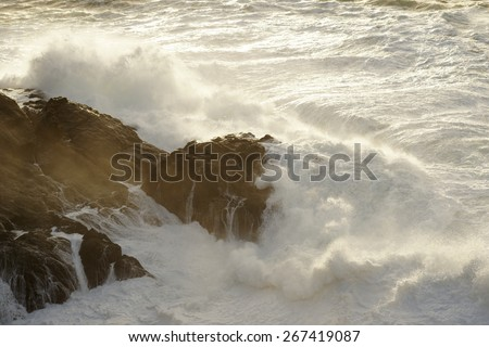 waves breaking on the cliffs on a stormy day in Corunna, Spain