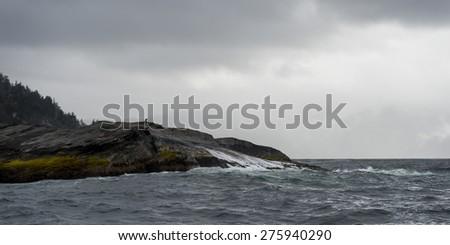 Waves breaking on the coast, Skeena-Queen Charlotte Regional District, Haida Gwaii, Graham Island, British Columbia, Canada - stock photo