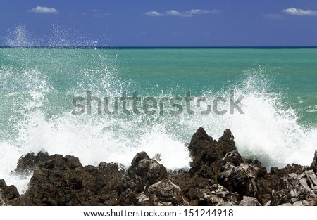 waves breaking on the rocks - stock photo