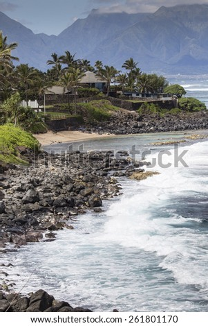 Waves breaking on the rocks on a sunny day during a spectacular ocean view Paia, Maui, Hawaii, USA - stock photo