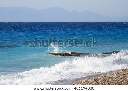 Waves breaking on the shore of the island. Azure sea storm - stock photo