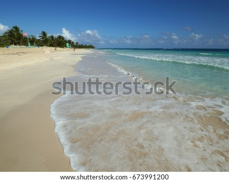 Waves covering the soft white sand of Flamingo Beach, Culebra, Puerto Rico