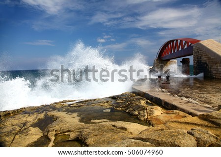 Waves crash against the Breakwater just outside Grand Harbour Malta