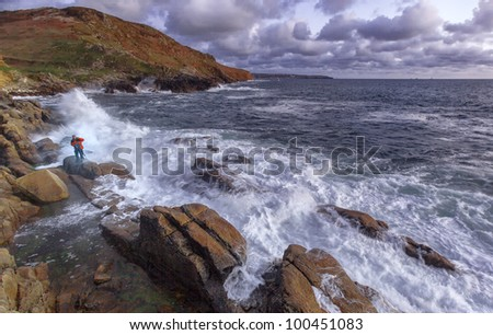 Waves crash against the rocks at sunset at Porth Nanven, Cornwall, England, United Kingdom, Europe