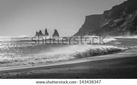 Waves crash into the rocky black beaches near Vik, Iceland.