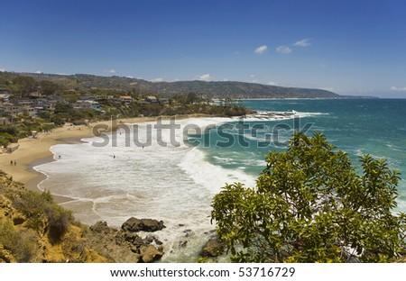 Waves crashing at Crescent Cove - stock photo