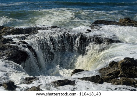Waves Crashing Down Thor's Well - stock photo