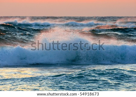 Waves crashing in the early morning sunlight