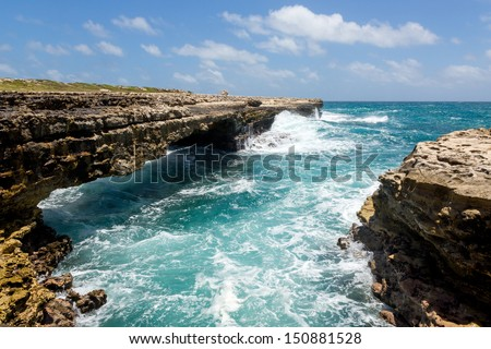 Waves Crashing on Rocks at Devil's Bridge Antigua in Sunshine