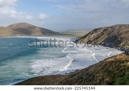 Waves crashing on the hilly shores of Ireland - stock photo