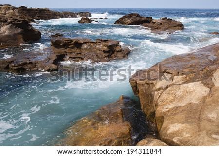 Waves crashing on the rocks. Atlantic ocean, France - stock photo