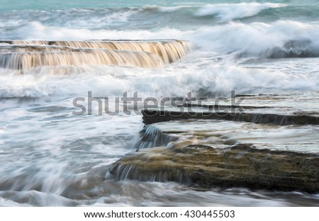 Waves crashing to sea rock  plates