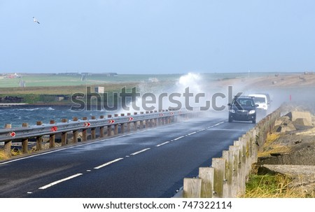 Waves crushing over the bridge in Orkney Islands, Scotland
