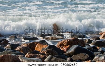 waves flowing over beach pebbles, Sailor's Grave Bay, Coromandel, New Zealand  - stock photo