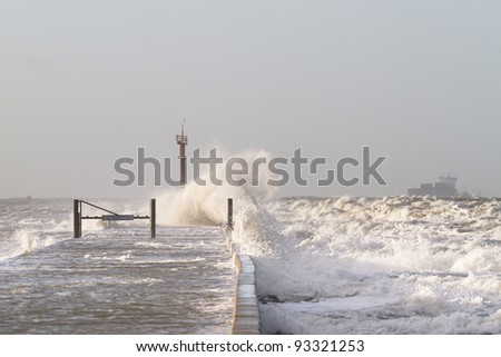 Waves hitting the pier - stock photo