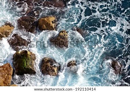 Waves hitting the sea shore - stock photo