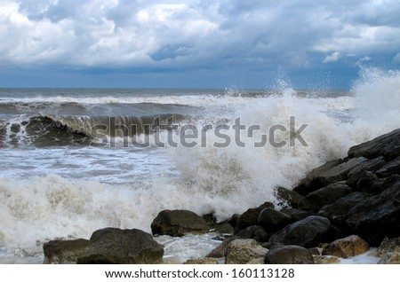 Waves hitting the shore - stock photo