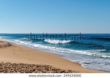 Waves in the Ocean Crashed on Sand Beach, sunny day - stock photo
